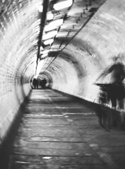 Through the Tunnel (shaunmck1) Tags: tunnel person people lines contrast bike walking london pentax abstract greenwich blackandwhite