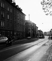 The Darker Side (Thomas Listl) Tags: thomaslistl blackandwhite noiretblanc biancoenegro urban architecture street road sunset evening light shadows contrast houses buildings zellerau würzburg bike branches vsco 35mm sun