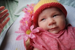 2 Granddaughter: side smile (Jen's Photography) Tags: portrait baby child grandchild jensphotography photographyaustin texas austin city urban centraltexas atx capitol capitoltexas austinphotography family pink infant granddaughter may 2018 spring flowers hat cap knit yellow nikon nikond70s d70s dslr