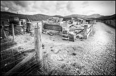 Abhainn Dearg distillery (Explored) (G. Postlethwaite esq.) Tags: abhainndearg bw canon40d hebrides isleoflewis redriver scotland sigma1020 blackandwhite distillery monochrome weedram wideangle sheds path fence whisky singlemalt