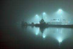 Harbour Lights II (Kojaniemi) Tags: water night boat trawler dock pier wharf streetlight kojaniemi mist misty fog foggy nightphotography harbour harbor port kimmoojaniemi haze hazy