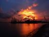 Fiery blast (elenaleong) Tags: westcoastpark seasisesundown sunset fieryblast fierysundown silhouettes cranes elenaleong