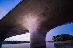 Bridge (Maerten Prins) Tags: netherlands nederland holland nijmegen lent bridge waalbrug waalbridge river waal nevengeul evening sunset longexposure concrete trees sky clouds