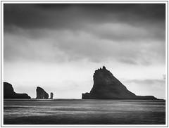 Approaching the Edge (adam_pierz) Tags: vagar seastacks sea water sky clouds faroeislands olympusomd micro43 microfourthirds blackandwhite monochrome bour