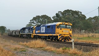 8138+8214 lead loaded grain train #3930 from the Riverina district of NSW through the locality of Carrick.