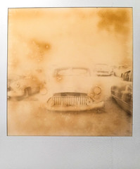 final resting place (Maureen Bond) Tags: ca maureenbond desert mojave junkyard film polaroid roidweek2018 impossible cars automobiles classics grill teeth headlights expired