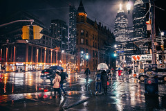 Wet (Paul Flynn (Toronto)) Tags: toronto city downtown street wet jarvis flatiron gooderham building water rain rainy reflection shine lights umbrella people sidewalk crossing
