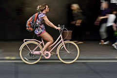The power of pink (jeremyhughes) Tags: london street cyclist cycling bicycle bike pink pinkbicycle pinkbike urban speed motion movement panning woman elegant stylish elegance style upright commuter summer colourful color people city nikon d750 nikkor afzoomnikkor80200mmf28ded 80200mmf28d