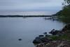 Calm dusk at Giddings Park (2/2) (danielhast) Tags: madison lake mendota wisconsin giddings park water lakeshore sky tree dusk clouds rocks pier boat project365 lakemendota