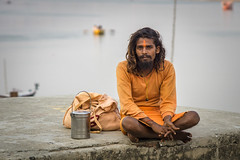 everything I own (andy_8357) Tags: everything i own hindu sadhu varanasi india orange ochre ganges ganga young man sony a6000 ilce6000 ilcenex mirrorless canon fd 50mm f14 wide open dof kind gentle purposeful portrait portraiture street photography long hair faith faithful devotion heartful choice sannyasi renunciate renunciation simple life spiritual water boat row e emount alpha 6000 mother