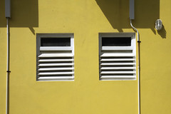Twindows (G-daddyArt) Tags: shutter stucco yellow wall light conduit shadow abstract canon50d