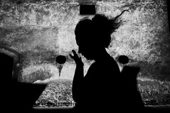 Live in Shadow (Bastex - Unknown Street Photographer) Tags: bw bnw woman cracow krakow krakau poland people street streetphoto streetphotography candid unposed cracowstreetcollective light documentary blackandwhite wall hair wind silhouette