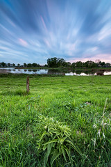 Dakhorst Long exposure (AtedV) Tags: blue green field water the netherlands ypelo enter almelo dakhorst fence grassland grass twente clouds cloudscape spring hour bluehour