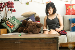 Reading book in morning (Hosting and Web Development) Tags: sit reading table indoor flower clothing casual face skirt arm asia morning relax life shoulder body black lights sofa young one person portrait female beautiful eyes d7100 hair hand horizontal nikon vietnam white woman officialnikkor