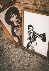 Dirty Harry Meets Calamity Jane (World View...Human Touch) Tags: allsubjects market window street reflections graffiti windows gallery sanwarzoné mannequins statues sanwarzone eldorado posters newmexico models model graffitilatienda artwork flea santafe places art