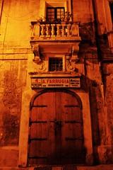 A. Farrugia Ironmonger (Douguerreotype) Tags: balcony door dark symmetry shop malta buildings architecture city window valletta night urban store sign
