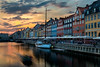 Nyhavn in motion under Sunset (roelbleeker) Tags: copenhagen denmark boat boats water bridge houses city cityscape sun sunset nikon d750 2401200 mm f40 yellow orange red blue sky white travel architecture traveling golden hour capital exposure scape