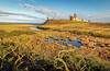 Winter sun at Dunstanburgh (urfnick) Tags: canon eos 1300d northumberland castle ruins fort battlements ocean sea pond lake marsh sky clouds landscape outdoors nature coast