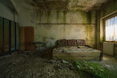 couch potato deluxe (dersonnenritter) Tags: light decay abandoned dry dark forgotten derelict shadow old exploring curtain table couch