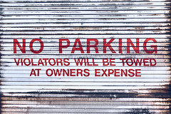 Towed (benpsut) Tags: noparking sign garage door rusty alley parking red white abstract street streetphotography photography