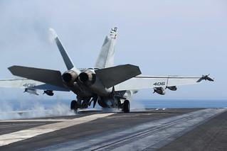 An F/A-18E Super Hornet launches from the flight deck.