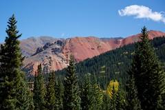 75 MPH Landscape (The Good Brat) Tags: colorado us iconic scenic drive road autumn landscape sky mountain trees forest green blue cloud gold aspen 75mph