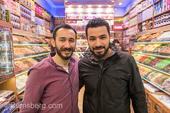Two Adult males smile and poses for photo together inside a sweets and dried goods shop, Istanbul Spice bazaar in Turkey (Remsberg Photos) Tags: bazaar market souk spice istanbul turkey egyptianbazaar commerce business retail shopping exchange commodities vendor portrait adult male merchant forsale together smiling happiness joy marketplace indoor products eminonuquarter fatihdistrict middleeast consumerism economy
