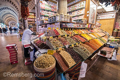 Male merchant setting up his corner market stall full of sweets and spices at the Istanbul Spice bazaar in Turkey (Remsberg Photos) Tags: bazaar market souk spice istanbul turkey egyptianbazaar commerce business retail shopping exchange commodities vendor bountiful abundant merchant forsale ingredient marketplace indoor choice storefront standing food freshness products eminonuquarter fatihdistrict spices flavor middleeast famousplace traveldestination corner consumerism economy