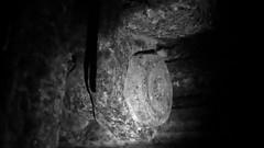 Consumed (Astral Eye) Tags: art artificiel amateur arme zoom rocher lumière humain human intérieur iron objet object pierre sombre dark flou gris grey horreur habitation light macro mineral minéraux minéral white couleur color colors couleurs blanc black noir net
