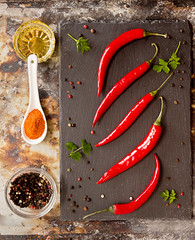 Red chili pepper on black background. Composition of group chili peppers. (alena.alekseeva.rudenko) Tags: pepper food vegetables chili red spice burning ground cayenne bellpepper hot spicy parsley metal slate board stone white black colors paprika objects backgrounds oil temperature seasoning raw ripe organic studio heat group image eating vegetarian healthy ingredient meal table racy powder photography kitchen bowl condiment vitality dried dry