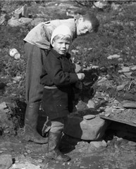 Helping out (theirhistory) Tags: children kids boy jacket trousers wellies boots