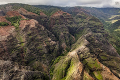 Kauai Heli Tour - Red Hills (lycheng99) Tags: helicopter maunaloahelicopter maunaloahelicoptertours kauai hawaii hill rocks rockformation red volcanicrocks volcano redrocks landscape scenery aerialview aerial travel nature waterfall water stream