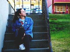Miriam (livsillusjoner) Tags: jeans jeansjacket brunette green grass stairs staircase outside outdoor norge tromsø troms blue white stripes black pale portrait people