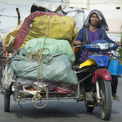 Loaded (Photosightfaces) Tags: rider dumaguete riding philippines motorbike motorcycle woman cart bags load loaded