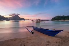 A little fishing boat in El Nido, Philippines at sun set - Christine Phillips (Christine's Phillips (Christine's observations) - ) Tags: green sunset philippines elnido christinephillips beach peace calm serenity bliss quiettime escape nature boat pink purple beautiful horizontal nopeople ship yact canoo