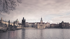 1942_Vintage panorama of Charles bridge (Ivanov Andrey) Tags: charlesbridge vintage old morning haze fog praguecastle rivervltava stvituscathedral basilicaofstgeorge lobkovicepalace architecture history building tower spire gothic fortress medieval temple knight castle sword shield battle cross arch catholicism religion christianity sky town tile blue sun wall walk travel cityscape prague czechrepublic ngc