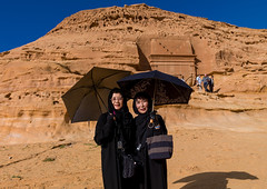 Japanese tourists in front of a nabataean tomb in madain saleh archaeologic site, Al Madinah Province, Al-Ula, Saudi Arabia (Eric Lafforgue) Tags: adultsonly alhijr alula arabia arabianpeninsula colourimage contemplation dedan desert frankincensetraderoad grave heat hegra horizontal humanbeing ksa ksa0754 madainsaleh madainsalih middleeast nabataean nabataeankingdom nabatean necropolis outdoors petra realpeople rock saudiarabia squarepicture threepeople tomb tourism tourist touristic travel twopeople umbrella unescoworldheritagesite womenonly almadinahprovince sa