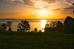 Sunset over the Chiemsee lake (echumachenco) Tags: sunset evening sky cloud tree grass field sun lake water reflection landscape outdoor serene chieming chiemsee upperbavaria oberbayern bavaria bayern germany deutschland nikond3100 april spring