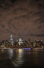 Gotham (Comiccreator24) Tags: digitalphotography digital photography lowermanhattan manhattan march2018 nyc nikonography nikon nikonphotographer nikond3400 nikondslr nikond3400photographer newyork ny atnight clouds cloudyweather usa dslr d3400 d3400photographer wtc onewtc freedomtower worldtradecenter oneworldtradecenter hudsonriver nightphotography night city cityscape cityskyline urban urbanography urbanamerica urbanjungle urbanphotography concretejungle vertical
