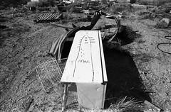 1330 (The Dent.) Tags: kodakhawkeyesurveillancefilm south australia coober pedy tmx dev 19 10 mins 2485 analogphotography nikon f100 24mm red filter desert outback wreckage