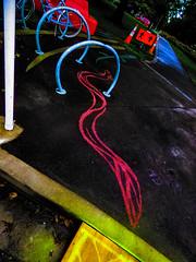 Straight Up Diagonally (Steve Taylor (Photography)) Tags: hagleypark eel cyclerack pole graffiti streetart sign cone road traffic path black blue orange yellow white dutchtilt dutchangle weird tarmac newzealand nz southisland canterbury christchurch park diagonal car bike bicycle