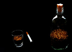 Tobacco is taboo (Charlotte P.Denoel) Tags: tosmoke taboo tabou sombre addiction noir glass verre bouteille bottle cigarette tobacco tabac filter