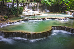 Staggered waterfalls (Syahrel Azha Hashim) Tags: 2018 laos sonyimages nature sony shallow holiday nopeople simple trees details a7ii waterstream highcontrast slowshutter kuangsiwaterfalls touristattraction asia clouds getaway handheld 35mm colorimage vacation luangprabang prime light sonya7 longexposure dramaticsky colorful dof beautiful travel syahrel relaxing stream colors destination freshwater naturallight greenwater detail
