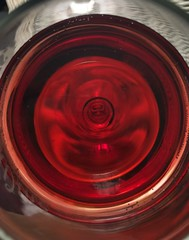 Red Wine to Ease the Mind (Blue Phthalo) Tags: reflections swirls glass redwine