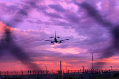 Big bird(Airplane Photography) (-> LorenzMao <-) Tags: airplane plane trudeauairport sunset framed montrealairport montréal montreal clouds quebeccanada canada canadaairport violet multicolor fence chickenwire airport