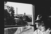 The Man on The Train (francoislinde) Tags: mature matte portrait window passingby buildings friendsoftherail character retro vintage skyline staring noir thoughts thinking lowkey man 2017 scenery pretoria travel sightseeing journey august monochrome passenger glasses blackandwhite hat steamtrain