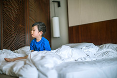 The baby boy sitting on bed after wake up at hotel (Yinjia Pan) Tags: 23years abundance familywithonechild loveemotion onebabyboyonly oneperson portrait tourism tranquility traveldestinations attitude babyclothing beautifulpeople bed blackeye blackhair carefree casualclothing cheerful child childhood chineseethnicity concentration curiosity cute domesticlife emotionalstress enjoyment facialexpression frustration happiness horizontal hotelroom indoors innocence joy lifestyles lightnaturalphenomenon lookingaway morning photography relaxation sadness sideview sitting wakingup