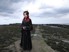 Cast Away P1180042 (The Lure of Salvage) Tags: gothic april beach stranger kindness sexy eerie strangegothic dark girl little grimm wgw fest goth whitby hollingworth fishfork salvage lure lureofsalvage gothik 2018 rock landscape mountain sky red hair black lipstick velvet dress