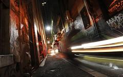 One way traffic (Shadyezz) Tags: night lane alley road track wet rain light red melbourne city graffiti streetart traffic lighttrails keepleft