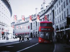Regent Street, London (The Phoenix Girl) Tags: regentstreet bus redbus cityscape london uk city urban composition street oxfordcircus flags nikon londoner timeoutlondon londonist architecture artwork edit photography unitedkingdom england greatbritain europe travel ukflag royalweddingflags
